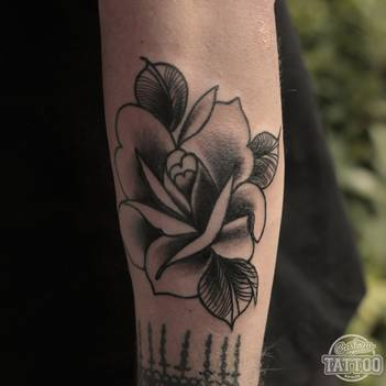 Neo traditional black rose tattoo