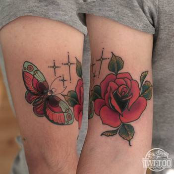 Neotraditional rose and buttlerfly tattoo